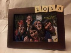 Hey guys, here is a cool idea for a senior gift. A picture frame with the graduation year on it. I just took scrabble peices, added number stickers to them, and superglued them to a frame, its so easy I did five of them in 10-15 minutes. Try it out, add some other stuff, or change it around a bit.