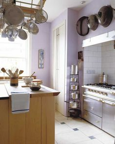 Lavender kitchen- Love it! Everything in Place: Kitchen Organization Tips - Healthy Home - Mother Earth Living Pot Organization, Household Organization, Organization Ideas, Storage Ideas, Purple Kitchen, Lavender Kitchen, Kitchen Hacks, Kitchen Stuff, Kitchen Storage