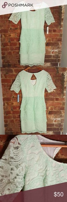 """Antonio Melani NWT Lace Dress Sz 2 A sea foam green lace dress with mid to 3/4 length sleeves. Features 2 tiers of lace, one peplum starting at the waist, and reaches my knee (I'm 5'2""""). Never worn! ANTONIO MELANI Dresses Midi"""
