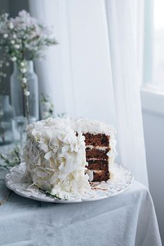 Carrot cake by Call me cupcake, via Flicke Beautifully decorated with large pieces of coconut