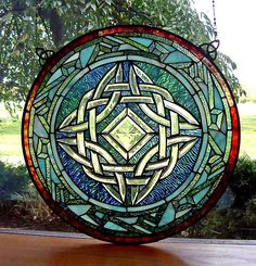 """Round Celtic Knot Stained Glass Window from """"Shop Irish"""". Stained Glass Designs, Stained Glass Panels, Stained Glass Projects, Stained Glass Patterns, Leaded Glass, Stained Glass Art, Mosaic Glass, Celtic Stained Glass, Window Glass"""