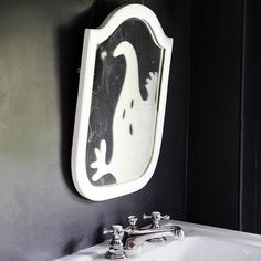 Even if you tend to be scared of your own shadow, you'll still smile at your reflection, thanks to this friendly spirit on your mirror.