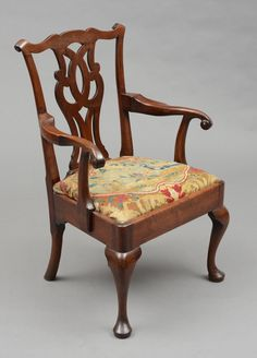 """English Antique George III Chippendale Period Armchair, Circa 1760  This period Chippendale mahogany open armchair has a serpentine top rail above a pierced interlaced splat, scrolling arms, deep seat apron, front cabriole legs ending in pad feet and drop-in seat with antique needlework covering.      English Circa 1760     Height: 38""""   Width: 25""""  Depth: 21.5""""     Item #6391     Price: $7,985  http://susansilverantiques.com/product/chippendale-period-armchair/"""