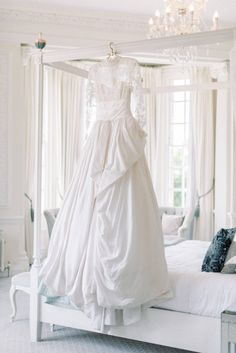 White Marchesa wedding gown with lace top longsleeves in chantilly lace; silk brocade ball gown full skirt; hedsor house light bright and airy bridal suite with canopy bed in white wooden style with accent; white nautral plain wedding preparation room with luxury glass chandelier | Photo by London and Newcastle UK based light bright and airy Filipina wedding photographer Cristina Ilao Wedding Venues Uk, Beautiful Wedding Venues, Destination Weddings, Wedding Blog, Autumn Wedding, Spring Wedding, Hedsor House, Garden Wedding Inspiration, Bridal Gowns