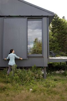 A Tiny Cabin is This Writer's Off the Grid Getaway - Photo 14 of 20 - When Alex or Bruce leave the island, closing up shop is as simple as sliding panels of corrugated metal into place to protect the windows. Metal Building Homes, Building A House, Building Ideas, Building Plans, Building Exterior, Architecture Durable, House Architecture, Casas Containers, Sliding Panels