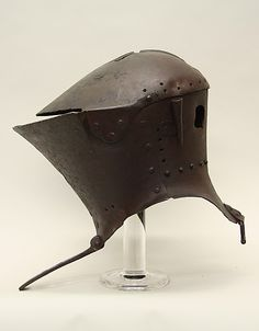 Tournament Helm ca. 1475–1500 Italian, Steel Very little Italian tournament armor survives from the fifteenth century, making this helm very rare. It was designed for use in the joust, a contest between two mounted combatants armed with blunted lances. The helm is stamped with an unidentified armorer's mark: PA beneath a crown.