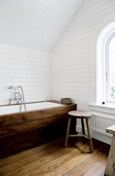 white bathroom, wood tub - The main thing that I love is the bright shiny white paint, which is probably, or at least should be, marine grade oil base paint for durability in a wet environment.  The other thing I love is the contrast between the beautiful wood floor and tub surround with the walls.