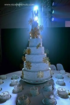 """Decorate a pristine white cake with glittering snowflakes to channel a """"winter wonderland"""" theme. Debut Cake, Debut Ideas, Winter Wonderland Theme, 18th Birthday Cake, Cake Ideas, Snowflakes, Ph, Channel, Decor"""
