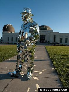 Mirror Man Suit - The Mirror Man is a sharp dressing street performer located in the Los Angeles area. He masks his entire body in hundreds of mirrors; creating a suit that covers his body from head to toe.