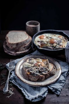 These creamy mushroom and black truffle baked eggs are an indulgent brunch recipe you're going to love. Mushrooms sautéed in butter, garlic, thyme and white pepper then topped with gruyere and truffle infused eggs – it's the perfect gooey home for some fresh crusty bread. | Food Photography | Food Styling | Food Props | Anisa Sabet | The Macadames