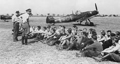 Hannes Trautloft and the men of IV./Jagdgeschwader 132 sit in front of a Bf 109E-1 (Nr 4072).