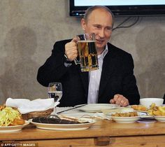 Knocking back the brewskis: Putin reaffirms macho image with football and beer…