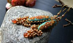 Pale Aqua Blue with shades of gold and rust clay Earrings by Peelirohini, $92.00