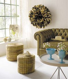 Not sure about the pom pom decor, but love the couch.