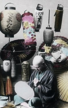 Hand-colored photo of lantern maker.  Early 20th century, Japan, by photographer Teijiro Takagi.