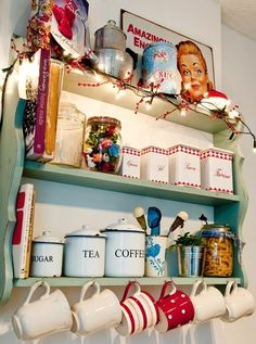 display and store mugs on hooks on front of shelves
