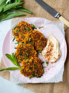 4 Ingredient Healthy Carrot Fritters {gluten free, dairy free, nut free} so simple and delicious! Served here with hummus. #vegetablefritters #glutenfree #healthy