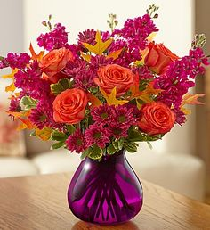 Plum Crazy ™ for Fall - A colorful blend of orange roses, lavender poms and more!