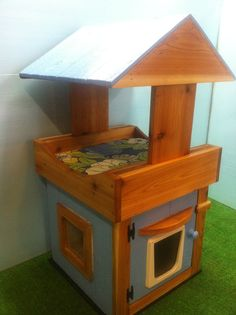 Outdoor Cat House/covered loft/heated pad/shelter/bed. $399.00, via Etsy.