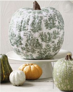 smashing pumpkins from the folks over at Country Living Magazine.  Using a decoupage, they have created these unique and totally refreshing ideas to decorate your home this season.