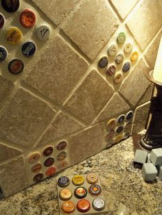 Bottlecap backsplash tile. Fun idea for a basement bar. LOVE IT
