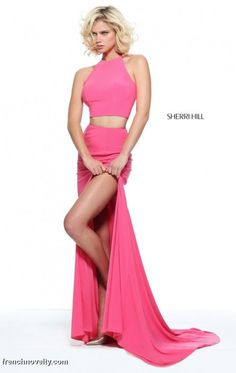 Size 4 Coral, Style 50784 from Sherri Hill is a slim two piece evening gown with a high neck top and a high slit in the skirt.