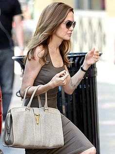 Angelina Joli carrying  her   YVES SAINT-LAURENT CHYC TOTE