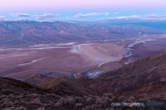 The pastel tones of sunrise illuminate Badwater Basin and Death Valley National Park from Dante's View near Furnace Creek, California.