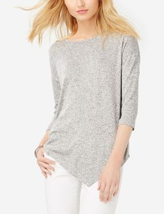 Marled Asymmetrical Hem Top - Comfortable and relaxed, this marled knit goes fashion-forward with an asymmetrical cut. Pair it with dark skinny jeans for a sleek and modern look.