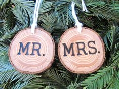 This custom wedding ornament was made from a branch of reclaimed wood. It has been cut, sanded, oiled, and branded with Mr and Mrs on the