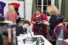 Signing copies of The Heir at the book launch.