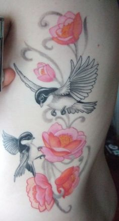 bird and flower and tattoo