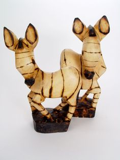Jacaranda Zebra.  Indigenous hard woods have become increasingly scarce so we have focused on developing products made from non-indigenous, non-endangered Jacaranda wood.  Carved from a single piece, these wood animals are beautifully polished and carefully crafted.  The zebra teaches us the beauty in individuality and integration of opposites.  $40.00