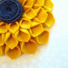 felt flower. I just made one, it took forever but was totally worth it!