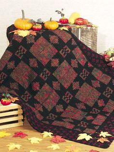 """Autumn Star Crochet Afghan Pattern  This crochet afghan has rich hues of autumn that bring to mind crisp days and colorful leaves in geometric designs. This crochet afghan pattern is easy enough for a beginner. Afghan size: 43"""" x 56""""   Skill level: Beginner  Designed by Lucia Karge  free pdf from free-crochet.com"""