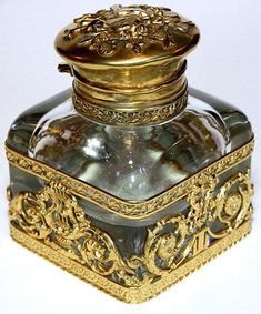 *ANTIQUE FRENCH EMPIRE DORE BRONZE CRYSTAL INKWELL LARGE:over sized antique French Napoleon III Empire Inkwell. Beautifully shaped thick heavy crystal which is most likely Baccarat, displayed in opulent ormolu mounts featuring musical insterments and lovely Cherubs. Thirty point hand cut star burst to base. Designed for dual use as a paper weight also. Dating from 19th century.