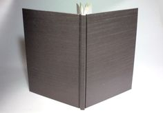 This version of the Bradel binding is a single signature in a hard case. It was sewn using a four hole pamphlet stitch. Before it ...