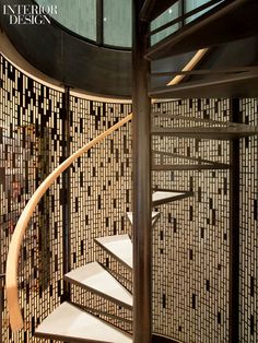 Spiral staircase with laser cut screen by Lewis.Tsurumaki.Lewis