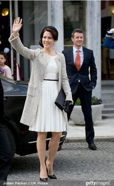 Crown Princess Mary repeated her Susanne Juul simple black calot hat. Paired with her grey bouclé coat, pleated cream silk dress and black accessories.