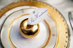 Gold apple place cards. Photography by facebook.com/TheWeddingBirds