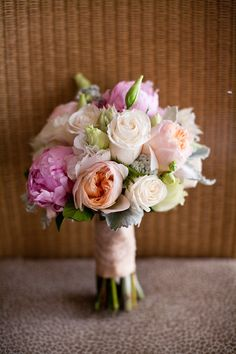 peach and pink bouquet. not bad - a slightly different color scheme. Get rid of that purple-ish color.