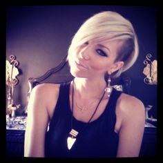 Blonde short hair with shaved side. Whitney Nunes