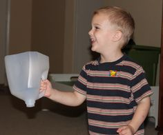 """We made this fun """"ball catcher"""" out of an empty plastic milk jug today. This is a simple idea – just cut the bottom off a milk jug! I can't remember where I found this idea, but I first used it with some kids that I babysat during college… circa 1998. It was a success …"""