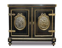 A rare Napoleon III cabinet with figured bronze reliefs - Furniture