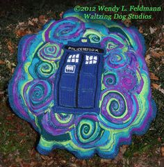 At last! The Doctor Who flavored crochet afghan (or blanket) made by Wendy L. Feldmann of Waltzing Dog Studios for her friend Eileen. It's the TARDIS. in space! All timey-wimey and stuff!    (pix courtesy of Judith Kuegler photography)