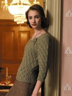 Knit this three-quarter-sleeve, lace stitch ladies' sweater with unique neck detail.