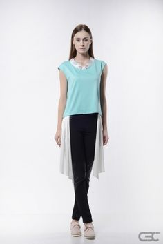 http://cbcdesign.ro/en/shop/tricou-pina-colada/ T-shirt from mint jersey with faux-kimono digitally printed collar and faux-layer from white voile. The colorful and comfortable T-shirt is completed by a fake layer of lightweight fabric on the inferior part, which, when in motion, gives off a playful vibe. It's easy to wear especially with tight bottom items, for a well-balanced look.