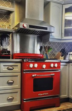 """This 30"""" cherry red Big Chill stove adds a pop of color to a customers stainless steel kitchen. What color would make your kitchen pop?"""