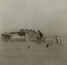 Farmer and sons walking in the face of a dust storm. Cimarron County, Oklahoma, USA     April 1936