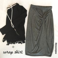 Gray Wrap Skirt NWT Gray wrap skirt! Adorable and super soft! Rayon spandex blend. Size small!  Discreet Skirts